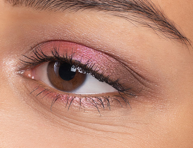 An eye with pink eyeshadow